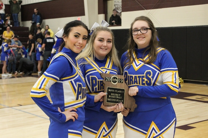 Senior Cheerleaders Nikki Ewing, Kelsi Kinney and Alex Parrack