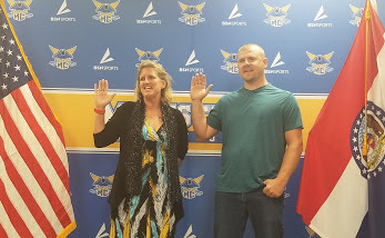 Sara Stoufer and Scott Gould taking the MCSB Oath of Office